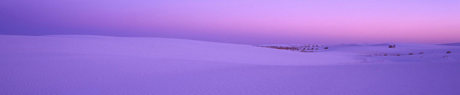Snowy field with a pinkish purple horizon
